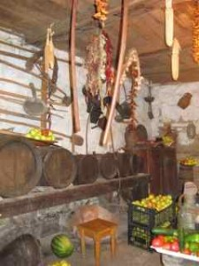 Georgian cellar with fruit, vegetables and wine